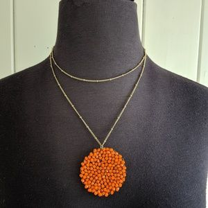 Beaded disc necklace can be worn long or short